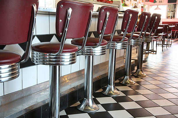 A line up of red diner style chairs  stock photo