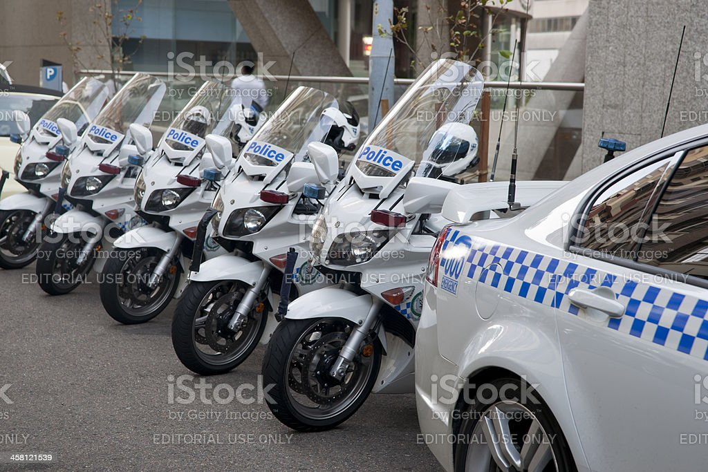 Line up, police car and motorcycles. stock photo