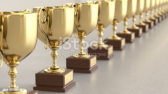 istock Linear Array of Gold Trophys on a Light Gray Surface 908151380