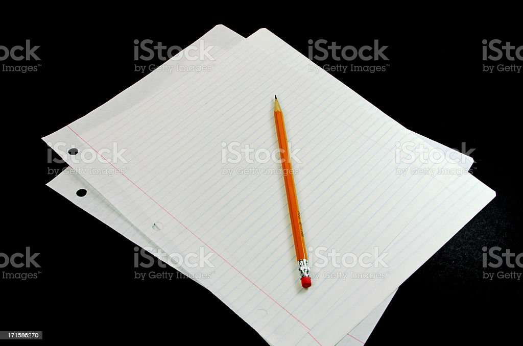lined paper and a yellow pencil waiting for a writer royalty-free stock photo