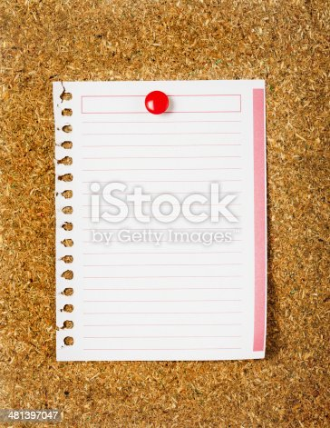 990092558 istock photo Lined paper on a cork board. Closeup 481397047