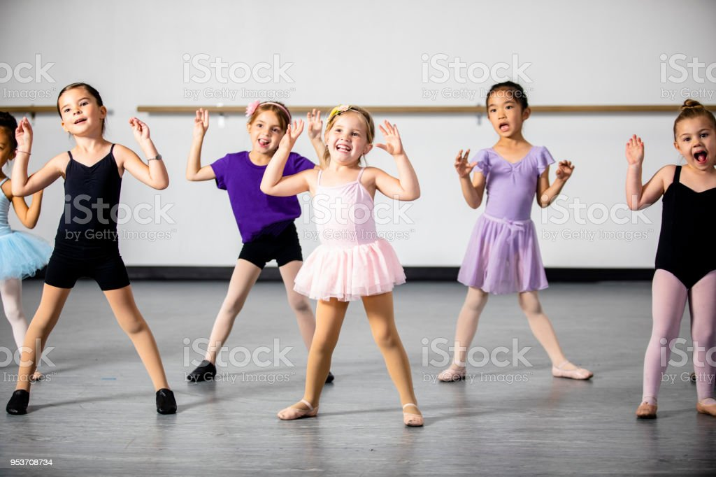 A diverse young group of students practice in musical theatre and...
