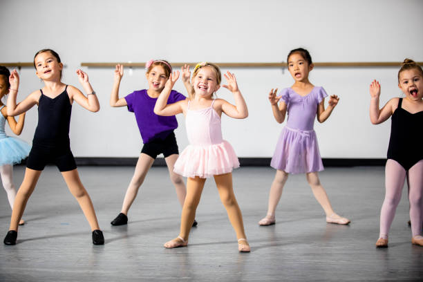 Lined Up Diverse Young Students in Dance Class stock photo
