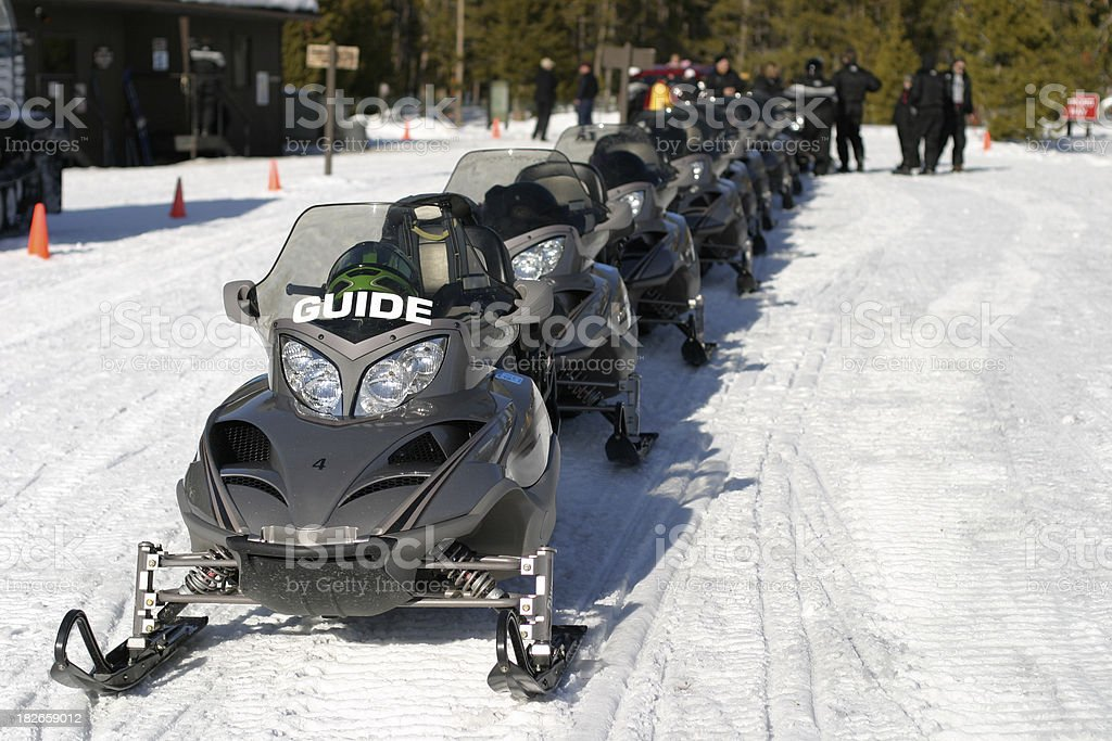 Lined-up snowmobiles royalty-free stock photo