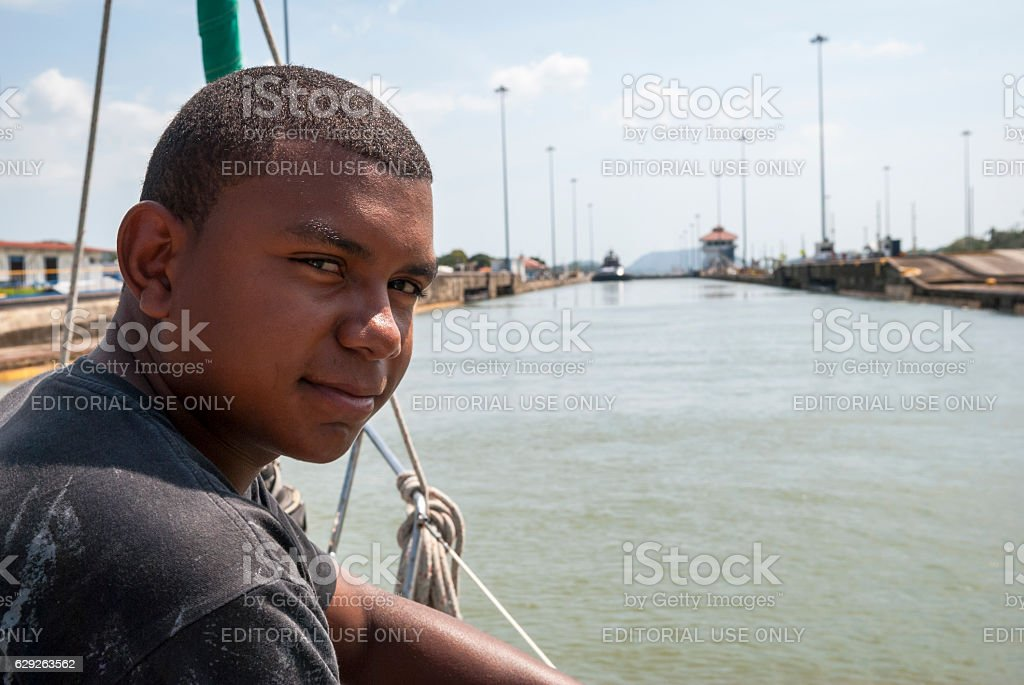 Line-handler on sailboat in Pedro Miguel Locks, Panama Canal stock photo