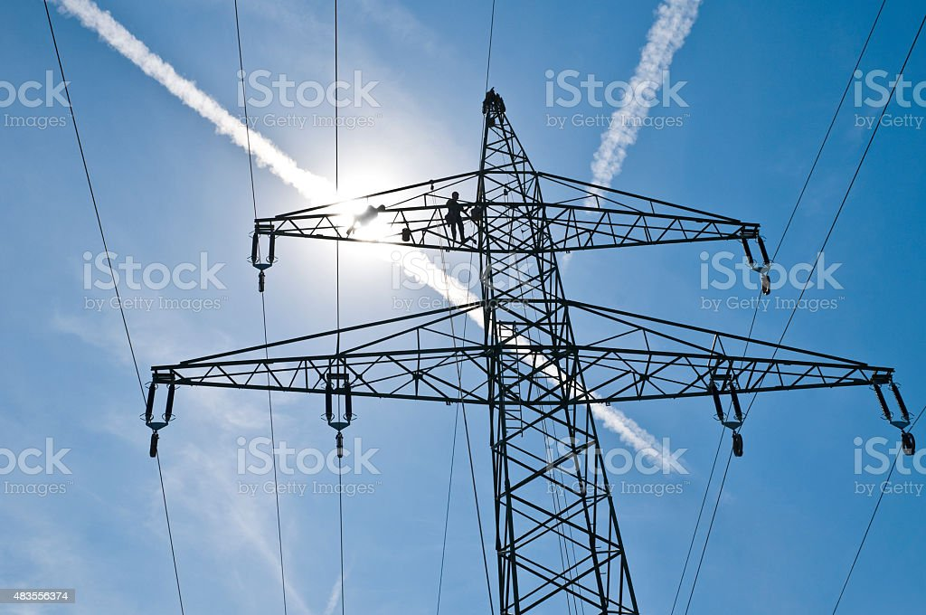 Linemen on a power pylon stock photo