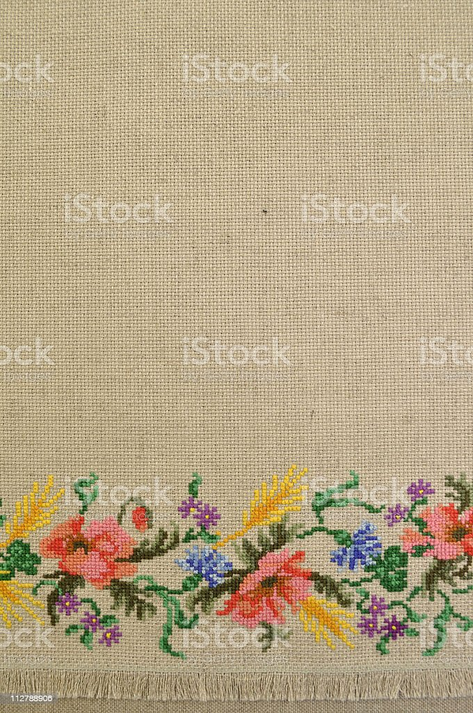 Linen canvas background with embroidery royalty-free stock photo