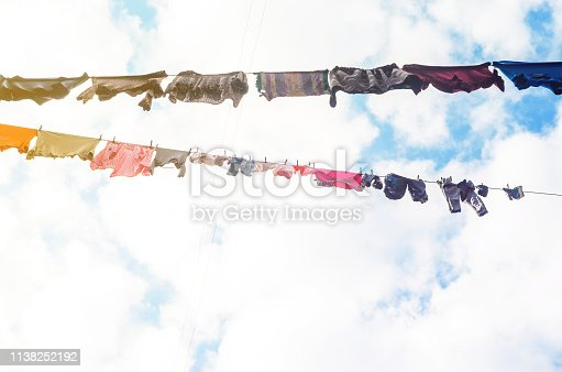 Linen is Dried on Clothesline on a Background of Blue Sky with Clouds. Sunny day