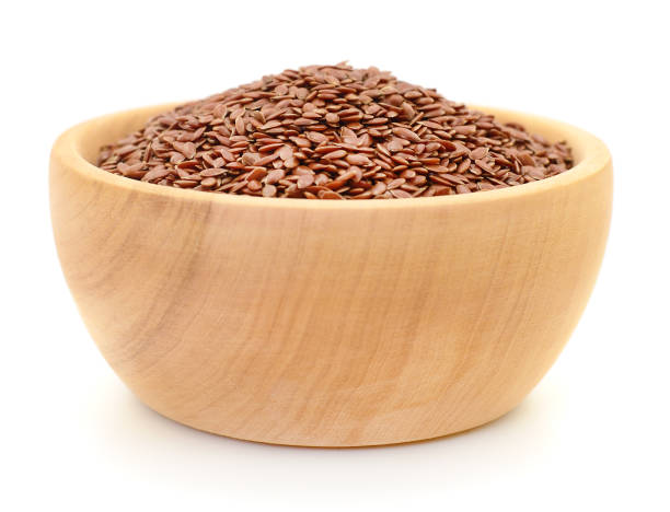 Linen seeds in wooden bowl.
