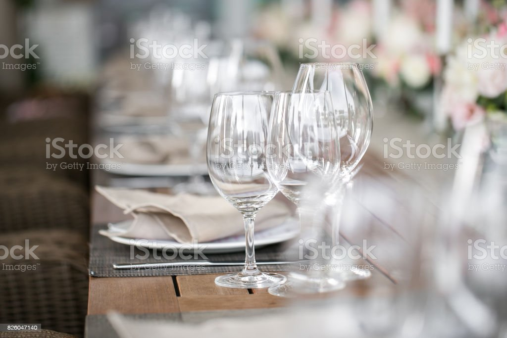linen textile. Decorated table, a plate of neatly arranged napkin, fork and knife. stock photo