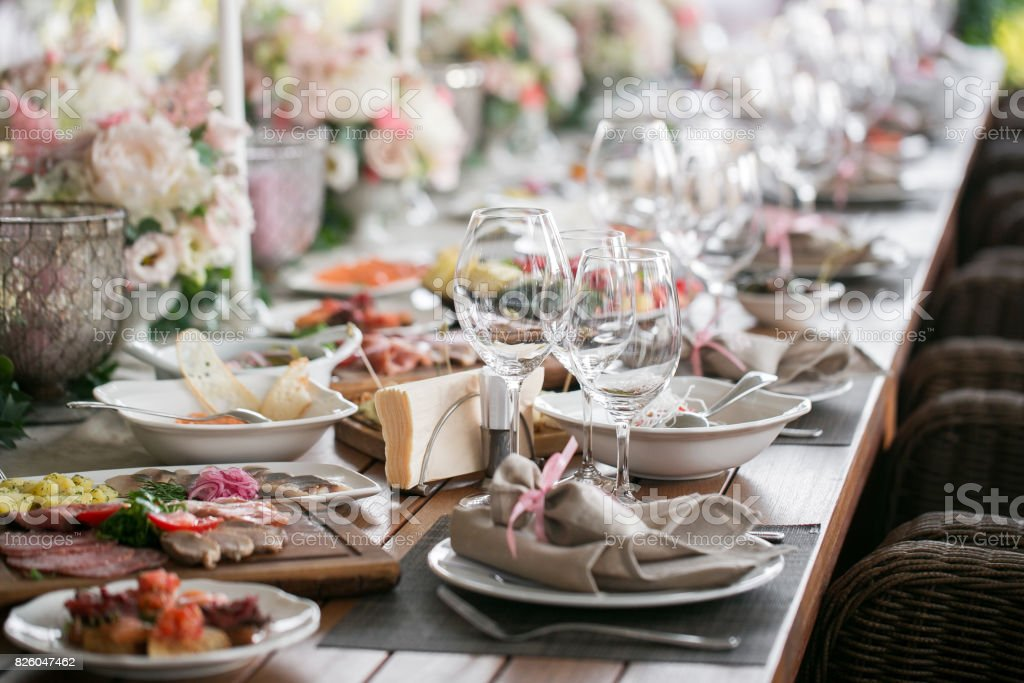 linen textile. Decorated table, a plate of neatly arranged napkin, fork and knife. selective focus stock photo