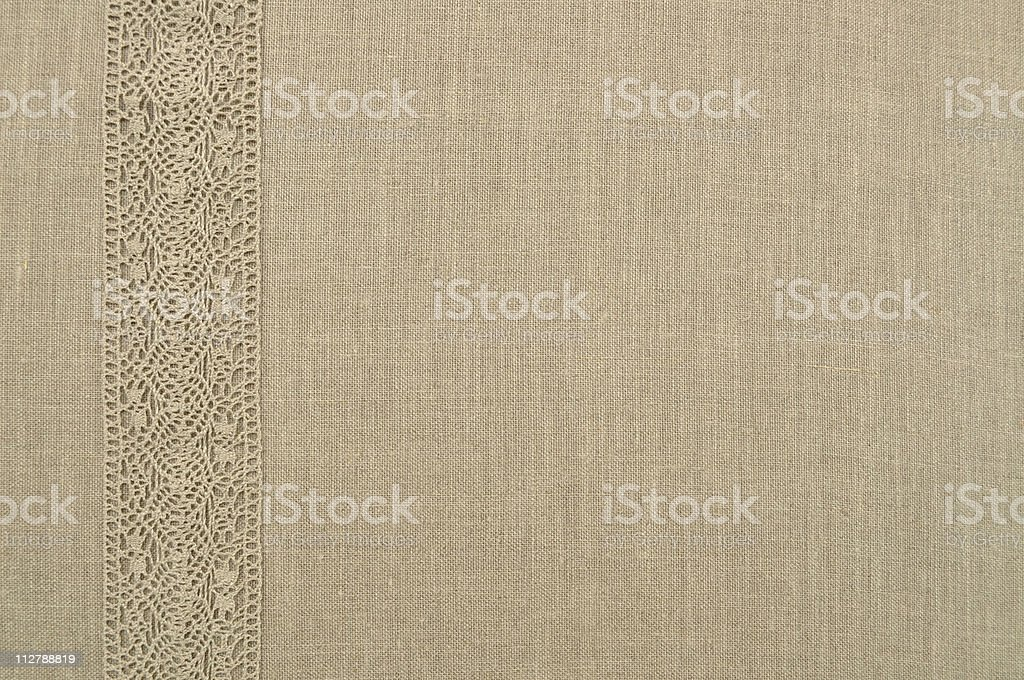 Linen uncolored background with lace royalty-free stock photo