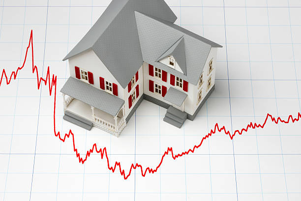 lines around a house on graph paper showing mortgage rates - mortgages and loans stock pictures, royalty-free photos & images