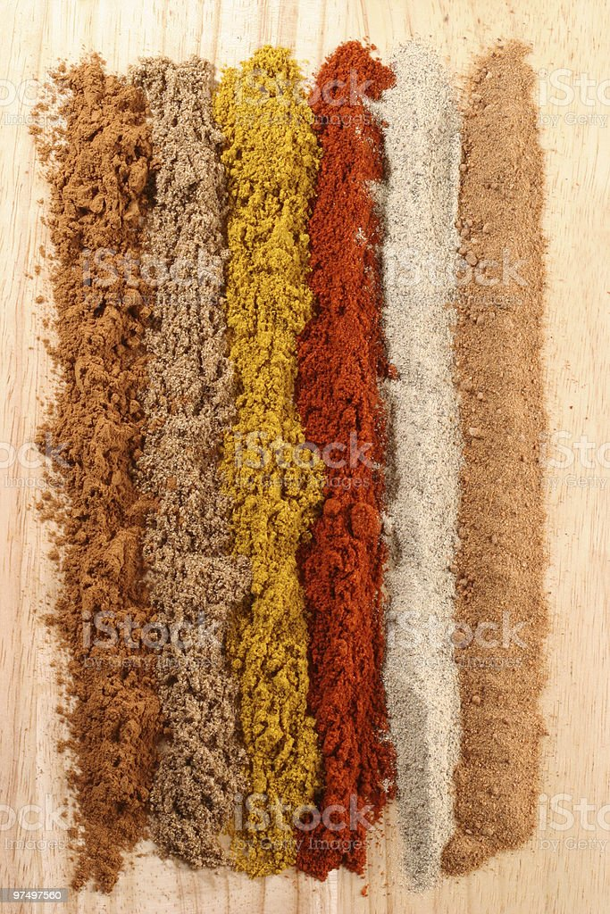 Lines of different spices royalty-free stock photo