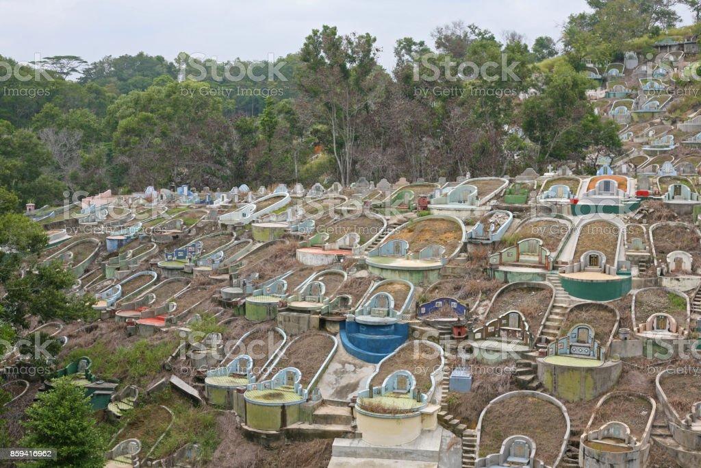 Lines of elaborate gravestones in a Borneo graveyard stock photo