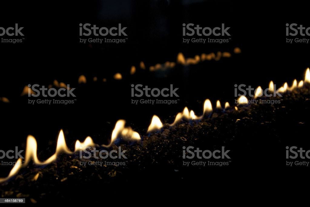 Lines of flames in a gas fire stock photo