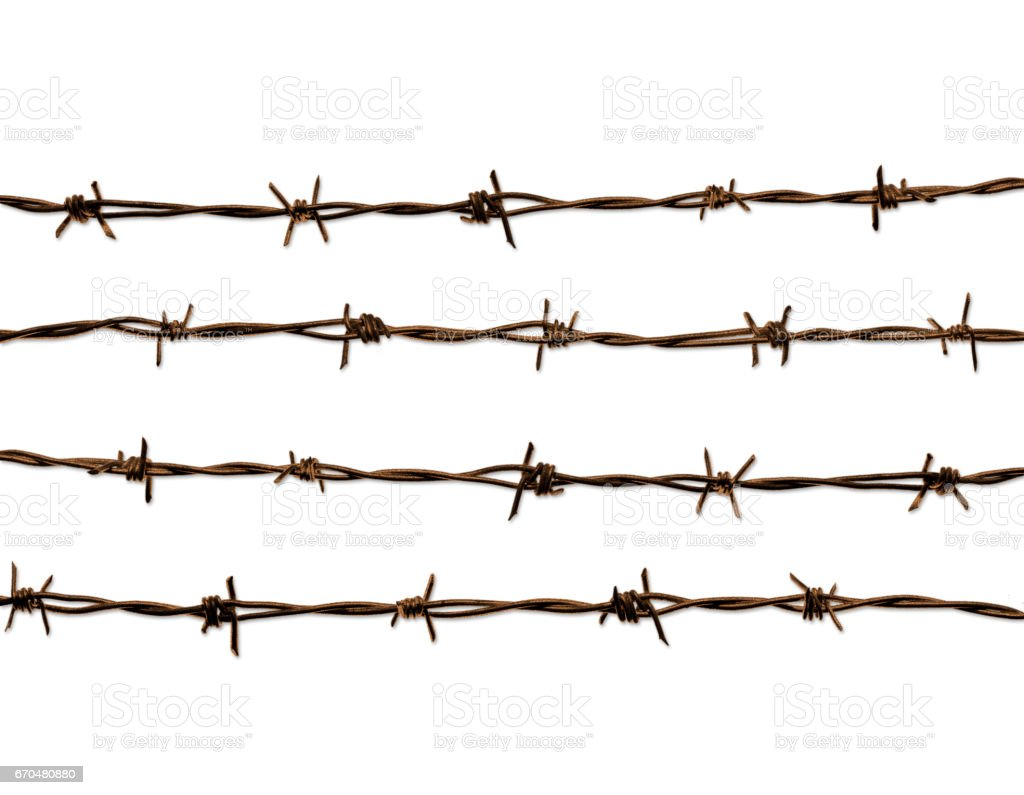 4 lines of old rusted barbed wire. stock photo