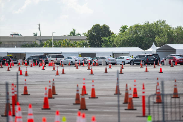 Lines of people in cars waiting to get Coronavirus testing at Miami Hard Rock Stadium test site