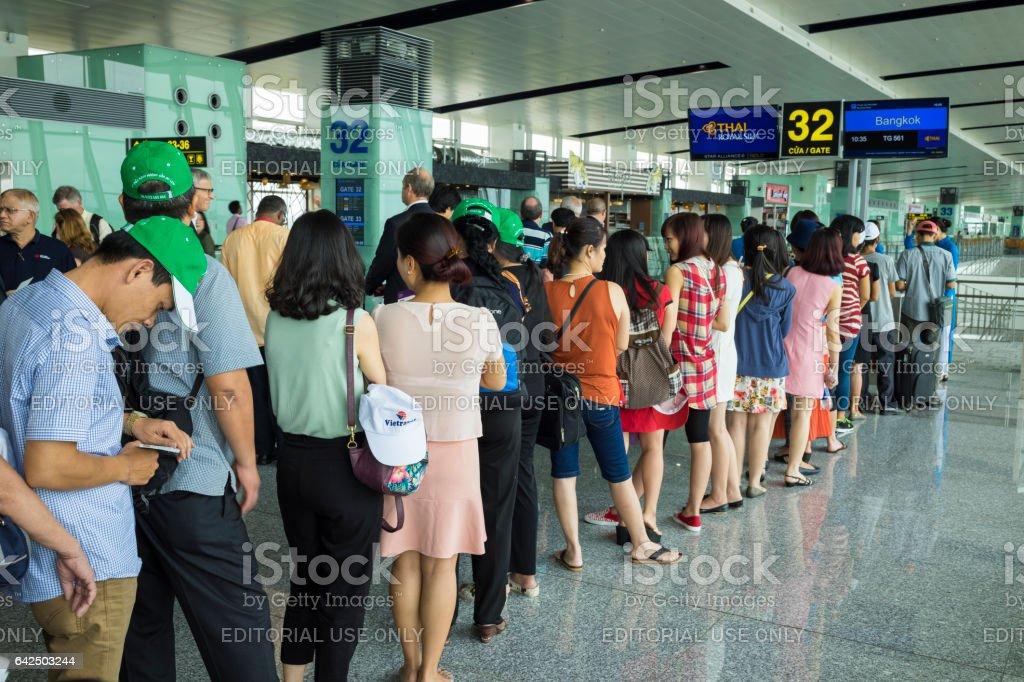 Hanoi, Vietnam - June 26, 2015: Lines of people waiting at boarding gate in Noi Bai International Airport stock photo