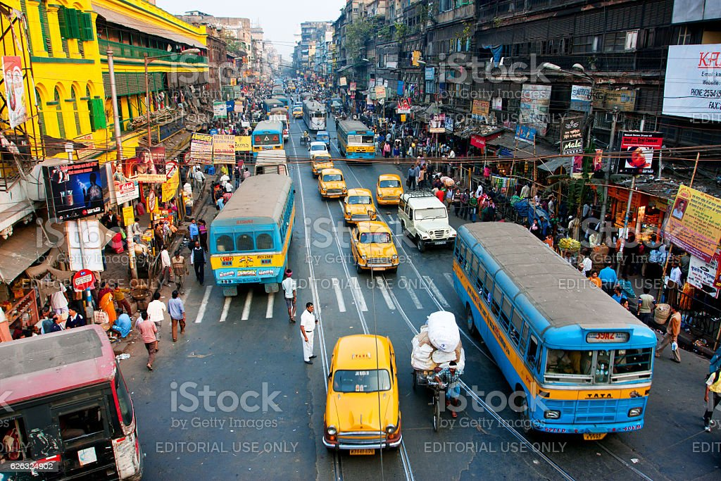 Lines of the yellow Ambassador taxi cabs and buses stock photo