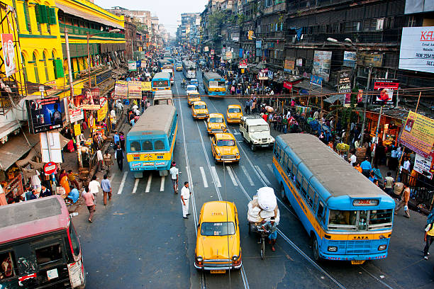 lines of the yellow ambassador taxi cabs and buses - india foto e immagini stock