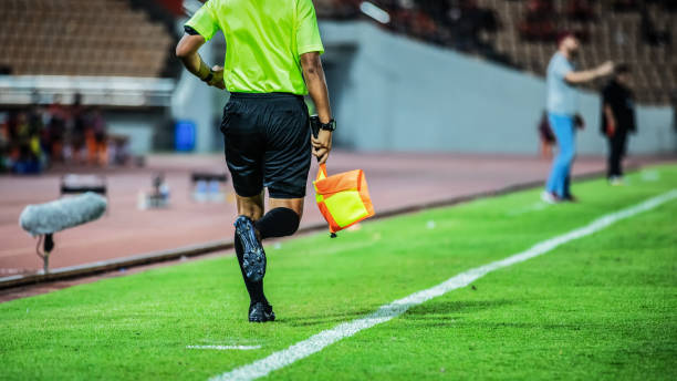 Linesman assistant referee action in the soccer stadium during match Linesman assistant referee action in the soccer stadium during match referee stock pictures, royalty-free photos & images