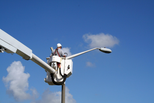 Utility worker installing a close-circuit video camera.