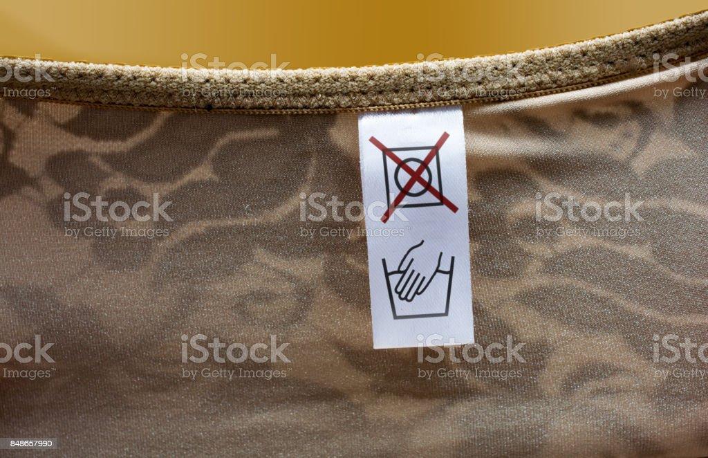 Dessous handwäsche nicht im trockner trocken etikett stock