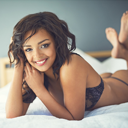Shot of a gorgeous young woman posing seductively in her bedroomhttp://195.154.178.81/DATA/i_collage/pi/shoots/805927.jpg