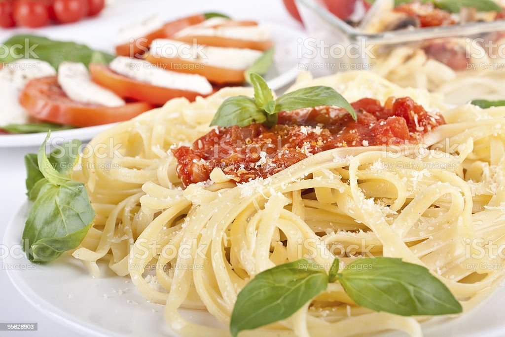 Linguine pasta with fresh tomato sauce and basil royalty-free stock photo