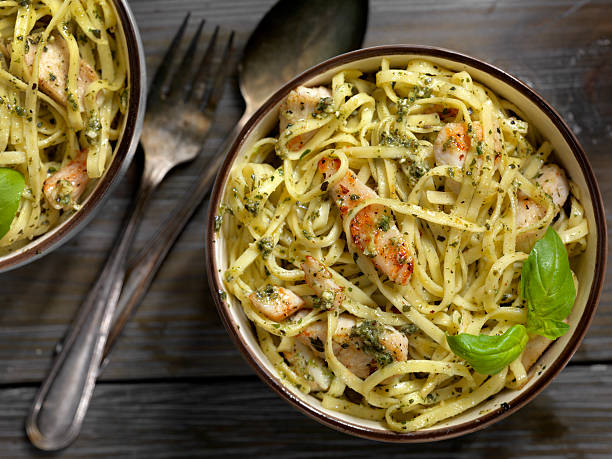 Linguine with Grilled Chicken and Basil Pesto Sauce stock photo