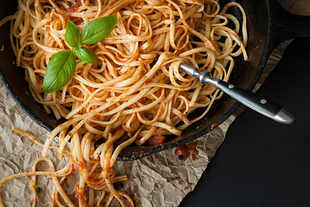 Linguine with Red Sauce and Fresh Basil stock photo