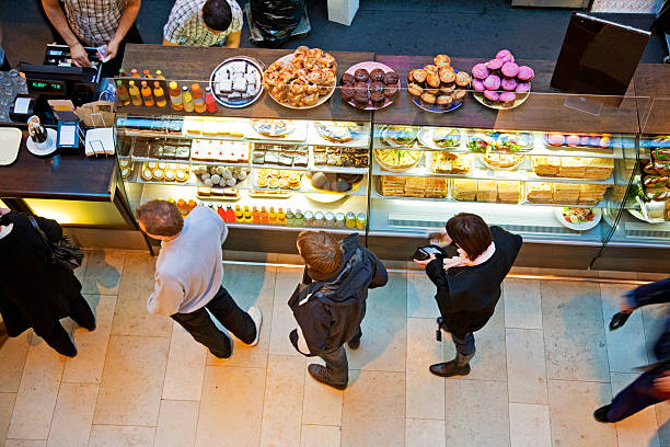 Lining up at cafe' with tasty pastry for a snack. stock photo