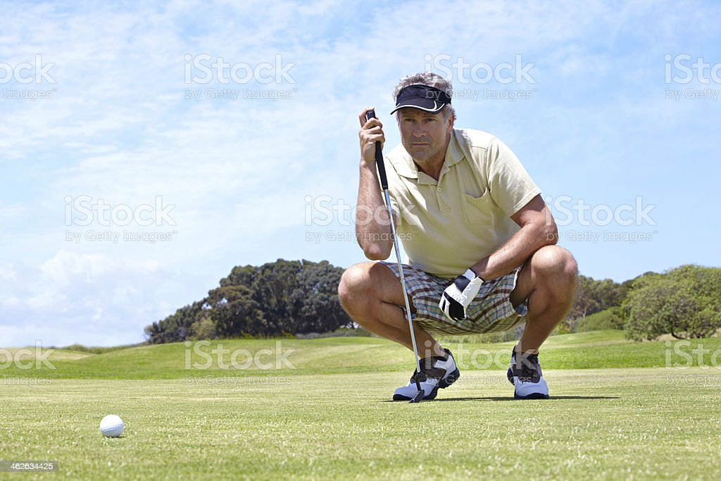 Lining up his shot stock photo