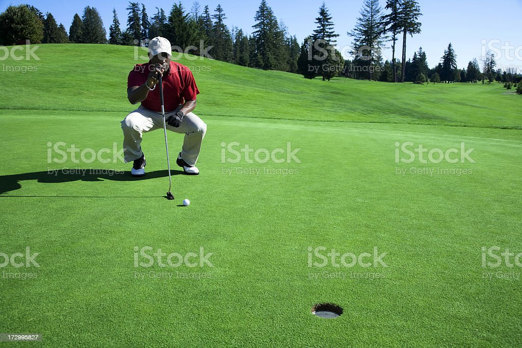 Lining Up The Putt stock photo