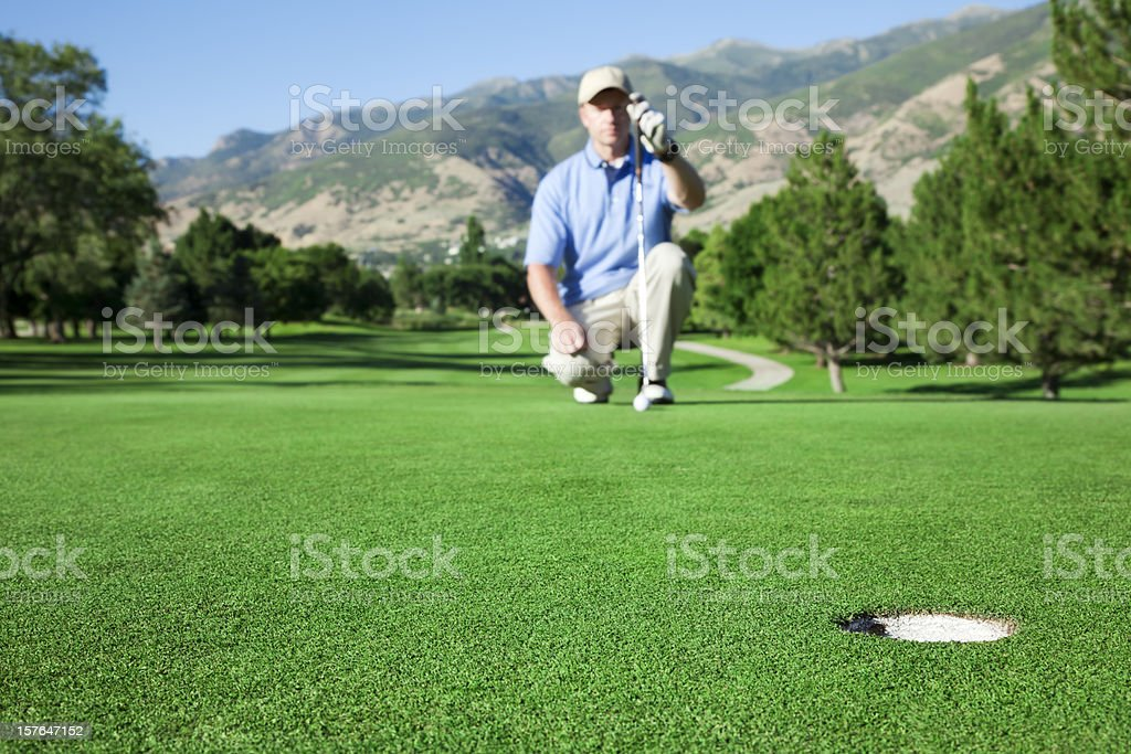 Lining Up to Putt royalty-free stock photo