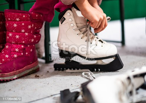 Close up girls hands linkage skates