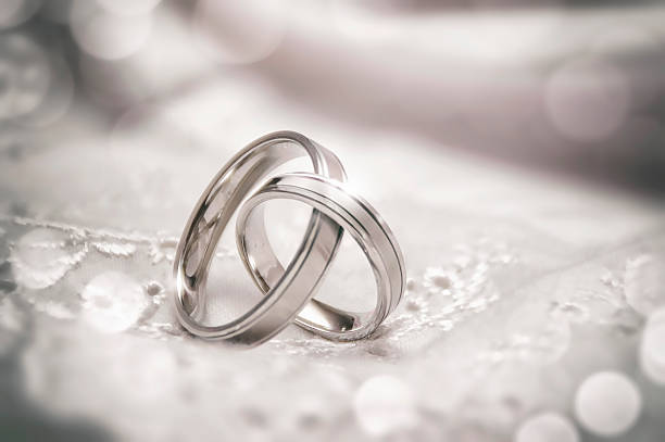 Linked Wedding Rings Two silver wedding rings linked together ring jewelry stock pictures, royalty-free photos & images