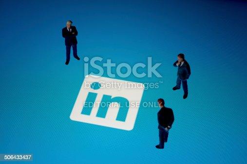 Seoul, korea - August 9, 2014 : Businessman figurines & Linkedin logo on Apple iPad. Linkedin is a business-related social networking website.