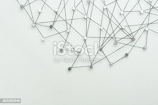 istock Linking entities. Network, networking, social media, internet communication abstract. A small network connected to a larger network. in paper linked together by cotton with a black tint 665380946