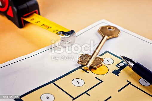 885968454istockphoto Linking new key on project plan of apartment house 874121990