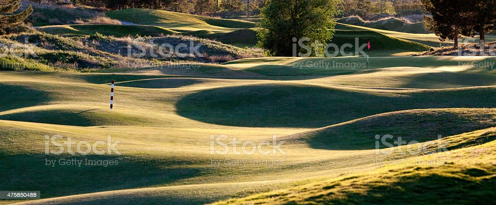 A beautiful rolling links golf course with low angled light. Links...