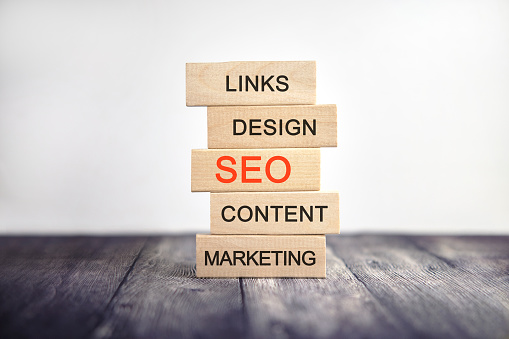 SEO, links marketing, design content - concept text on wooden cubes