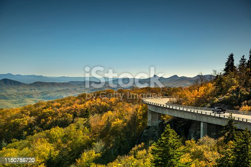 Cars travel on the Linn Cove Viaduct highway road on the Grandfather Mountain along the Blue Ridge Parkway in autumn North Carolina USA