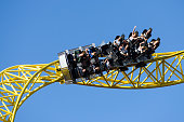HELSINKI, FINLAND - AUGUST 02, 2016: Linnanmaki Amusement Park, people having fun on the up and down Ukko steel roller coaster, tallest and fastest roller coaster in Finland (opened in 2011)