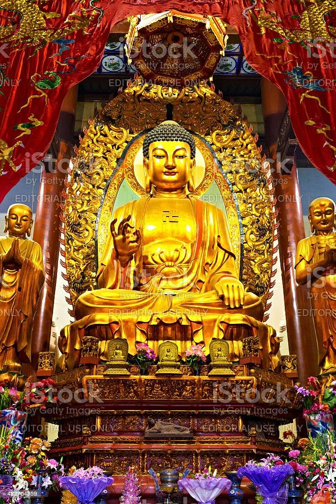 Linshan,China-Febru ary 05,2014:Golden buddha in temple on Febru royalty-free stock photo