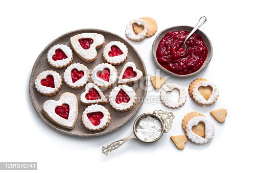istock Linzer cookies biscuits heart shape with strawberry jam on white 1291070741
