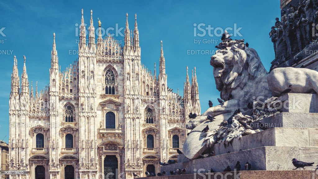 Lion and Milan Cathedral in Milan, Italy stock photo
