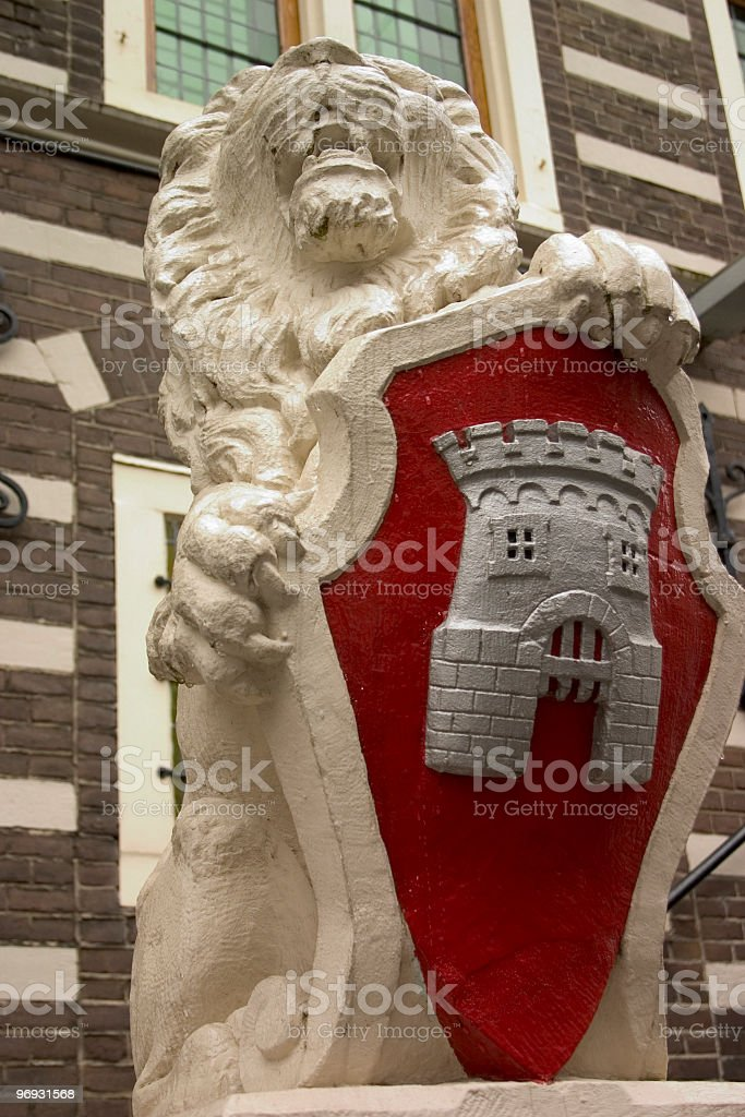 Lion and shield royalty-free stock photo