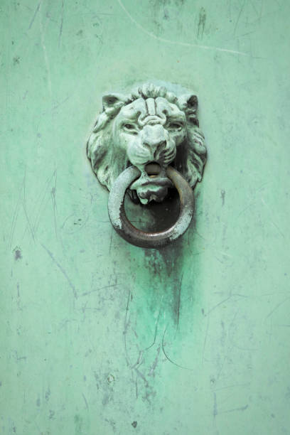 Lion Crypt Door Handle A very old and weathered lion head door handle on a crypt. sdominick stock pictures, royalty-free photos & images